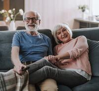 happy-elder-couple-enjoying-time-together-at-home-picture-id1141960076-1